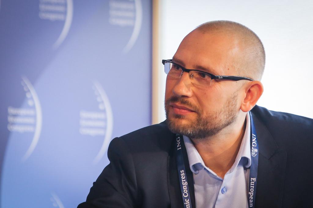Współprowadzący sesję Piotr Woźniakiewicz, dyrektor w PwC